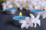 White hyacinth with candles on wooden background