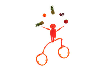 Healthy eating. Little funny juggler made ??of pepper.