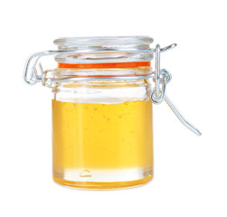 Sweet honey in glass jar isolated on white