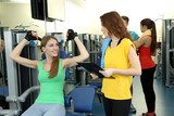 Young beautiful girls in gym