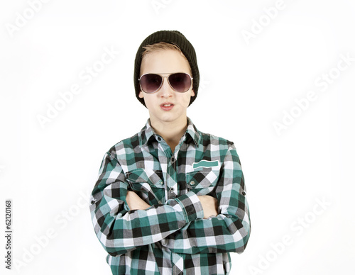 Boy in sunglasses and a cap. Youth fashion.