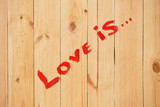 Love sign on wood texture