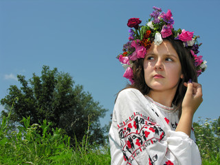 frightened ukrainian girl in traditional clothes