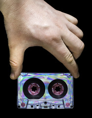 Hand holding vintage cassette tape