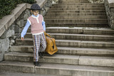 Exterior stairs and child with vintage bag
