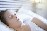 closeup of a beautiful young woman asleep in bed