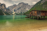 Hut on Braies Lake in Dolomiti mountains and Seekofel in backgro