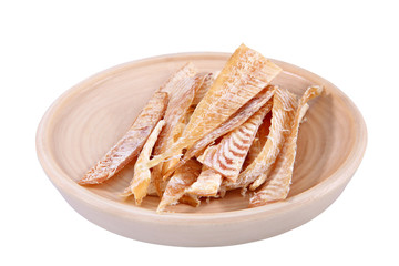 Slices of dried fish on wooden plate isolated over white.