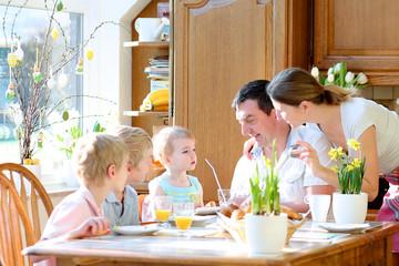 Family of five having breakfast on Easter day