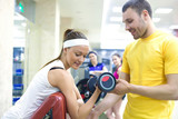 woman with instructor in gym