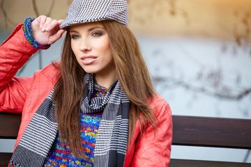 Portrait of smiling woman wearing woolen accessories