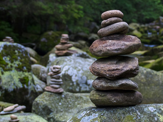 Pebbles, stacked stones as a stone statue, short depth of field