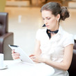 Business woman using tablet on lunch break in cafe