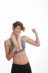 healthy slim woman showing muscles.