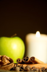 Green apple, cinnamon, walnut and a candle