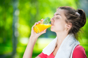 Woman drinking fresh orange juice