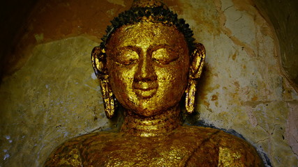 Face of the stone Buddha statue close-up. Bagan, Myanmar