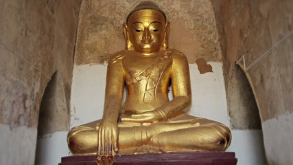 Stone statue of a sitting Buddha close up. Bagan, Burma