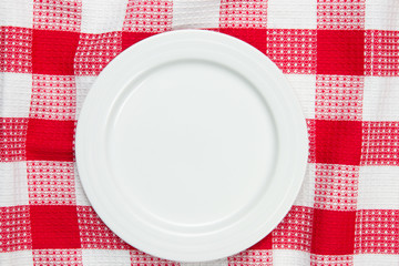 white dish on checkered table cloth