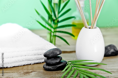 zen basalt stones and spa oil on the wooden table