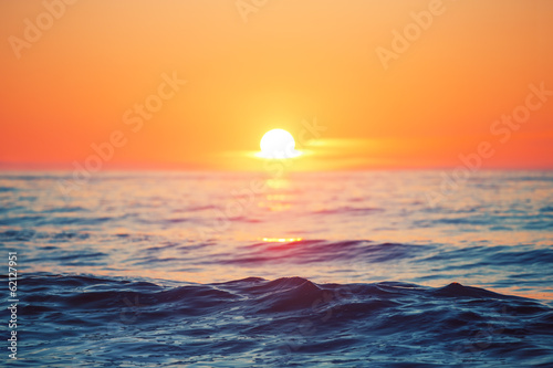 Poster Strand Sunrise over sea