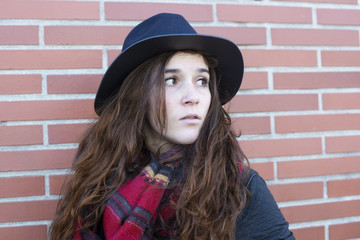 Portrait of attractive woman with hat and looking away.