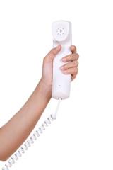 Hand holding white telephone tube