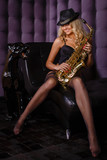 Beautiful woman with saxophone.