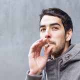 Portrait of man smoking a cigarette.