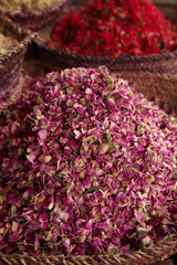 spices herbs flowers (rose) in the Marrakesh street souk shop