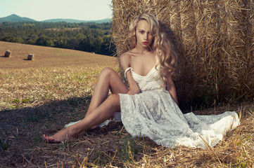 Sexy blonde in hayfield