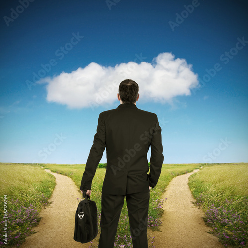 businessman in front of the options of the different ways