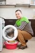 guy  doing laundry with washing machine