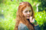 portrait of the rural red-haired girl