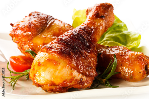 canvas print picture Grilled chicken legs and vegetables on white background