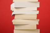 Stack of Paperback books on a red background
