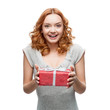 attractive cheerful woman holding gift