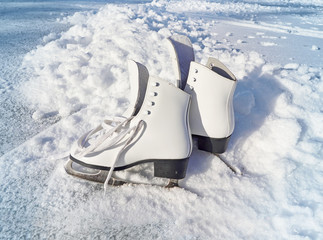 Women white skates. Abstract background on a winter sports theme