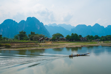 Boat on river on mountains background, Laos