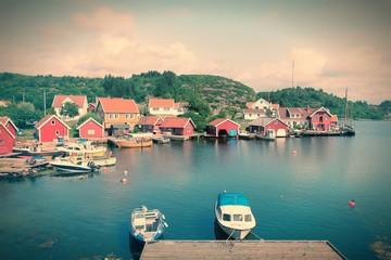 Norway harbor - Skjernoya island. Cross processed color tone.