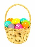 Easter basket filled with colorful eggs isolated on white