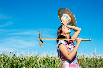 Female farmer working in corn field
