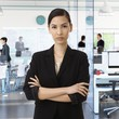 Asian businesswoman at busy corporate office