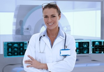 Mid-adult female doctor in MRI room at hospital