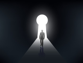 silhouette of a man walking in the light from the keyhole