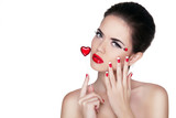 Beautiful pure woman with glamour bright makeup holding red hear
