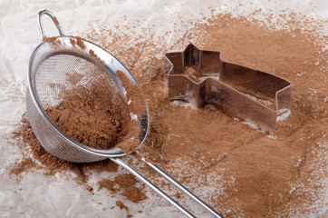 cocoa powder in a sieve and cookie cutter