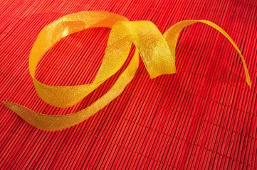 Festive red background with gold ribbon
