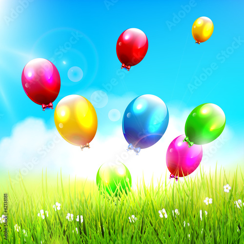Colorful balloons flying on the spring field - happiness concept