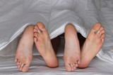 Pareja de pies en la cama- Feet in the bed-